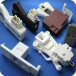 Washing machine door switches or interlocks
