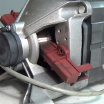 Fitted washing machine motor carbon brushes in a Indesco & welling motors