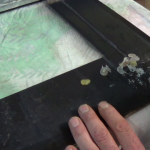 Scraping off old heat proof glue from cooker oven door
